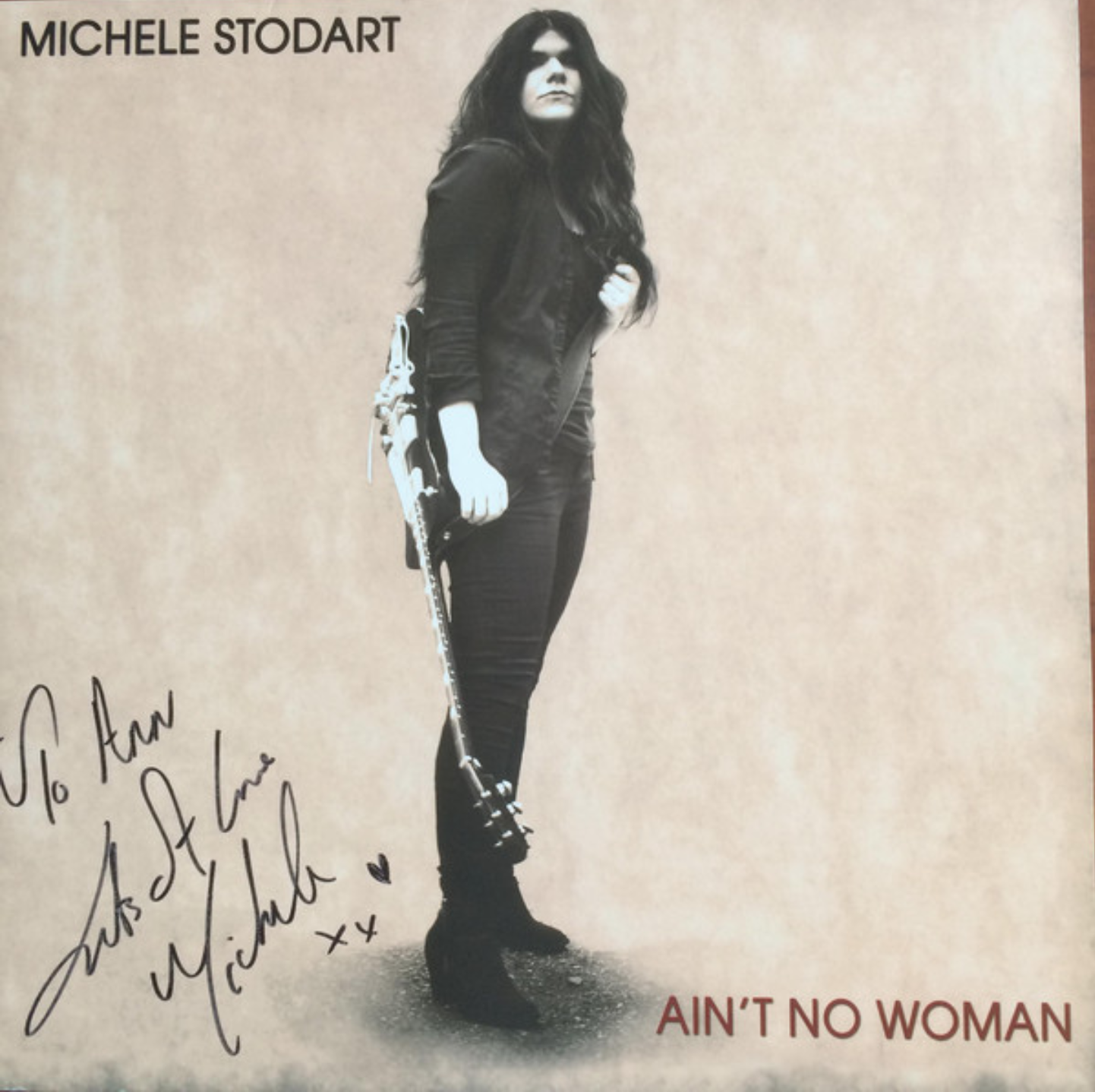 Michele Stodart standing with guitar on vinyl single cover